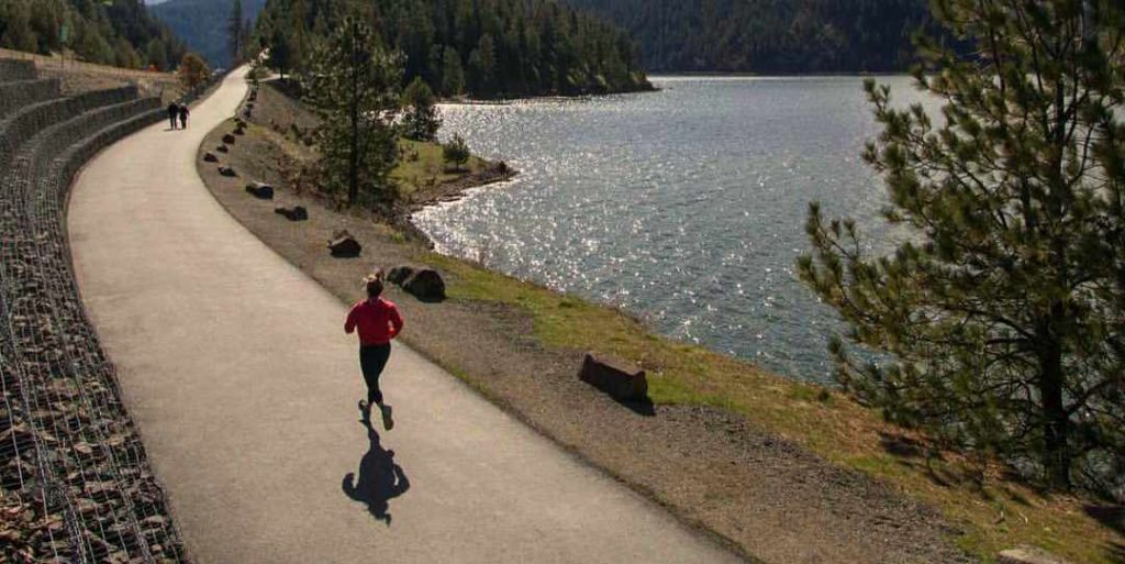 Runner on North Idaho Centennial Trail at Higgen's Point in Cd'A
